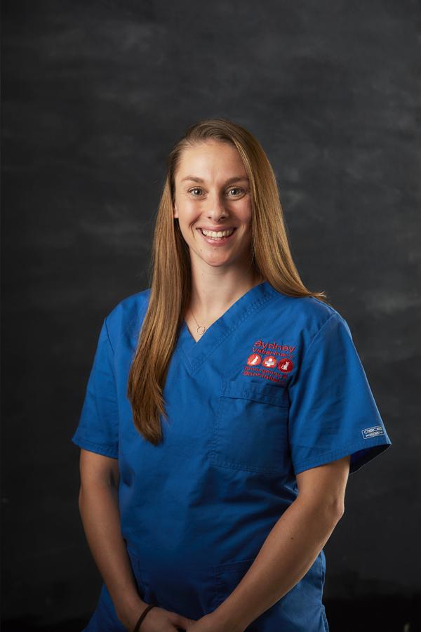 Smiling Portrait image of Vicky Higgins from nursing team wearing blue nurse suit