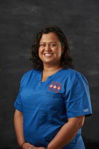 Smiling Portrait image of Natalia S from Sydney Vetenarys Administration wearing blue nurse suit