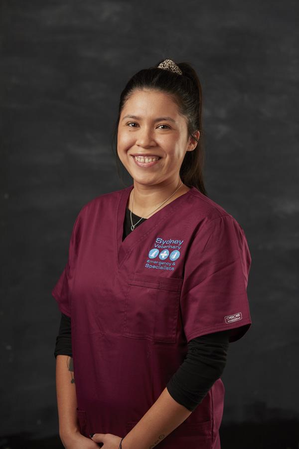 Rachel T from Animal Attendant Team wearing red nurse suit